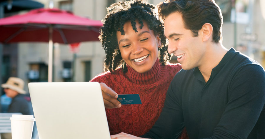 man and woman using a credit card online